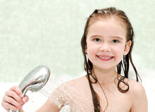 Happy little girl closeup taking shower. In bath Stock Photo