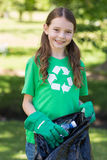 Happy little girl collecting rubbish Stock Images