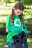 Happy little girl collecting rubbish Stock Image