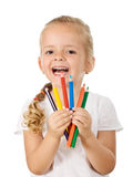 Happy little girl with colored pencils stock photography