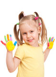 Happy little girl with colorful handprints Royalty Free Stock Image