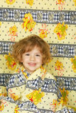 Happy little girl in colorful linen Stock Photos
