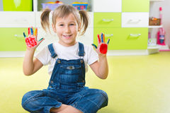 Happy little girl with colorful pains on hands Royalty Free Stock Photography
