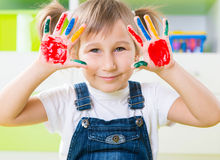 Happy little girl with colorful pains on hands Royalty Free Stock Images