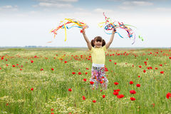 Happy little girl with colorful ribbons Stock Photos