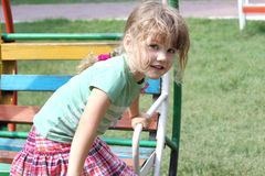 Happy little girl on colorful swing Royalty Free Stock Images