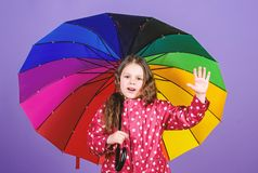 Happy little girl with colorful umbrella. autumn fashion. cheerful hipster child in positive mood. rain protection stock photo