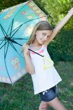 Happy little girl with an umbrella Stock Photography