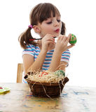 A happy little girl coloring easter egg Royalty Free Stock Image