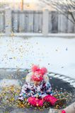 Happy little girl with confetti on the trampoline stock photos