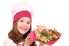 Little girl cook with burritos Royalty Free Stock Photos