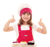 Happy little girl cook and cakes Royalty Free Stock Images