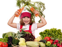 Happy little girl cook with carrots Royalty Free Stock Photography