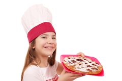 Little girl cook with cherry pie dessert on plate Royalty Free Stock Images