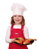 Happy little girl cook with chicken drumsticks Stock Photo