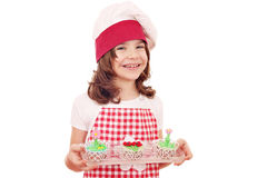 Happy little girl cook with cupcakes Royalty Free Stock Photos