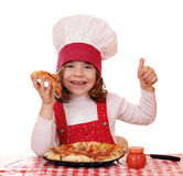 Little girl cook eat pizza Stock Photos