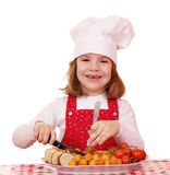 Little girl cook with gourmet food Stock Photo