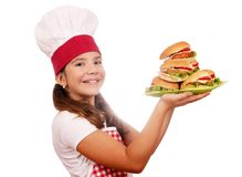 Little girl cook with hamburgers on plate Royalty Free Stock Photos