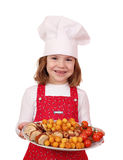 Happy little girl cook hold plate Royalty Free Stock Image