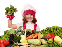 Happy little girl cook holding radish Stock Images