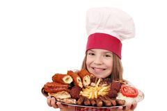 Little girl cook with mixed grilled meat on plate Royalty Free Stock Images