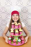 Little girl cook with muffins dessert Stock Images