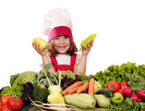Happy little girl cook with peppers Stock Images