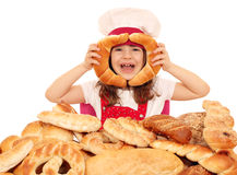 Happy little girl cook with rolls Stock Photos