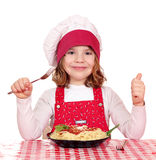 Little girl cook with spaghetti Royalty Free Stock Images