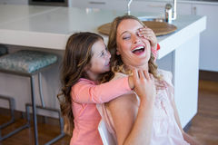 Happy little girl covering her mother eyes Stock Images