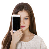 Happy little girl covers her face screen smartphone Royalty Free Stock Photography
