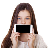 Happy little girl covers her face screen smartphone Stock Image