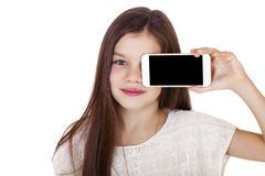 Happy little girl covers her face screen smartphone Stock Photography