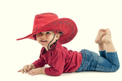 Happy  little girl cowboy in a red hat on a white Royalty Free Stock Images