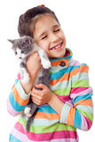 Happy little girl cuddle kitten. Isolated on white Royalty Free Stock Images