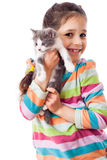 Happy little girl cuddle kitten Royalty Free Stock Photo