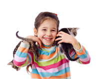 Happy little girl cuddle two kitten Royalty Free Stock Photo