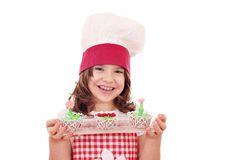 Happy little girl with cupcakes Royalty Free Stock Photos