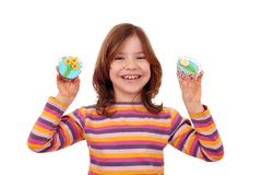 Little girl with cupcakes decorated as spring flowers. Happy little girl with cupcakes decorated as spring flowers stock photo