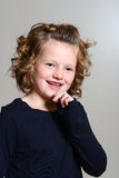 Happy little girl with curly hair Stock Photography