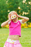 Happy little girl with daisies Royalty Free Stock Photo