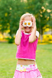 Happy little girl with daisies Royalty Free Stock Photography