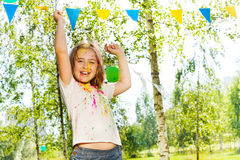 Happy little girl dancing on Holi color festival Royalty Free Stock Photo