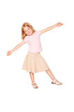 Happy little girl dancing. Isolated on white Royalty Free Stock Photography