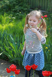 Happy little girl with dandelions Stock Images