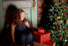 Happy little girl  decorate Christmas tree Stock Images