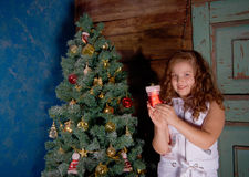 Happy little girl  decorate Christmas tree Royalty Free Stock Images