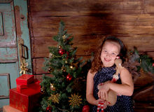 Happy little girl  decorate Christmas tree Stock Photography