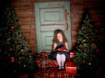 Happy little girl  decorate Christmas tree Stock Photos